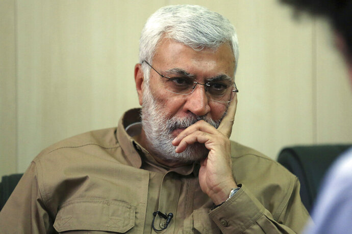 FILE - In this May 29, 2016, file photo, Abu Mahdi al-Muhandis listens to a question during an interview in Fallujah, Iraq. Al-Muhandis, a veteran Iraqi militant who was closely allied with Iran, was killed overnight Friday, Jan. 3, 2020 in a U.S. strike that also felled Iran's top general. Al-Muhandis was the deputy commander of the Popular Mobilization Forces, an umbrella group of mostly Shiite paramilitaries. (AP Photo/Khalid Mohammed, File)