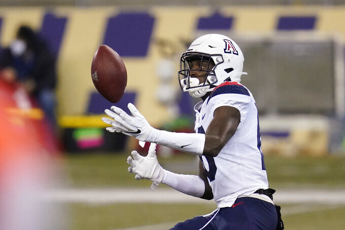 Arizona's Ma'jon Wright briefly juggles the ball before finally getting control on a pass reception against Washington during the second half of an NCAA college football game Saturday, Nov. 21, 2020, in Seattle. Washington won 44-27. (AP Photo/Elaine Thompson)