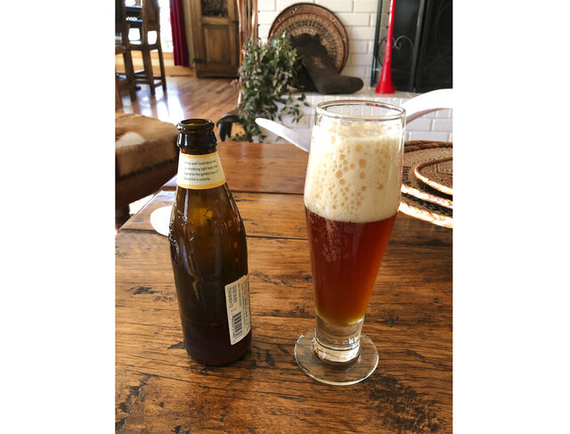 This April 11, 2020 photo shows a glass of home brewed German-style hefeweizen in Salem, Ore. Homebrewing provides an escape from dwelling on the COVID-19 pandemic. (AP Photo/Andrew Selsky)