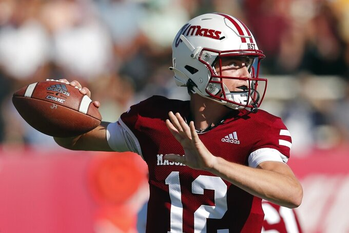 Massachusetts quarterback Brady Olson (12) looks to pass during the first half of an NCAA college football game against Boston College, Saturday, Sept. 11, 2021, in Amherst, Mass. (AP Photo/Michael Dwyer)