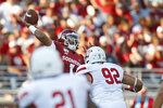 Oklahoma quarterback Jalen Hurts (1) throws under pressure from South Dakota defensive lineman Kameron Cline in the first quarter of an NCAA college football game Saturday, Sept. 7, 2019, in Norman, Okla. (AP Photo/Sue Ogrocki)