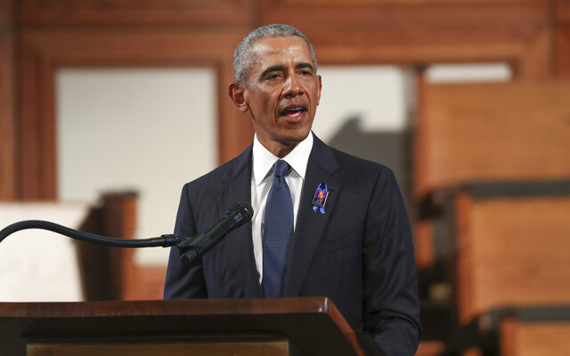 FILE - In this July 30, 2020, file photo, former President Barack Obama, addresses the service during the funeral for the late Rep. John Lewis, D-Ga., at Ebenezer Baptist Church in Atlanta. Obama is returning to Philadelphia for his first in-person 2020 campaign event for Joe Biden.  (Alyssa Pointer/Atlanta Journal-Constitution via AP, Pool)