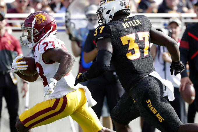 Southern California running back Kenan Christon (23) runs in for a touchdown as Arizona State linebacker Darien Butler (37) pursues during the first half of an NCAA college football game, Saturday, Nov. 9, 2019, in Tempe, Ariz. (AP Photo/Matt York)