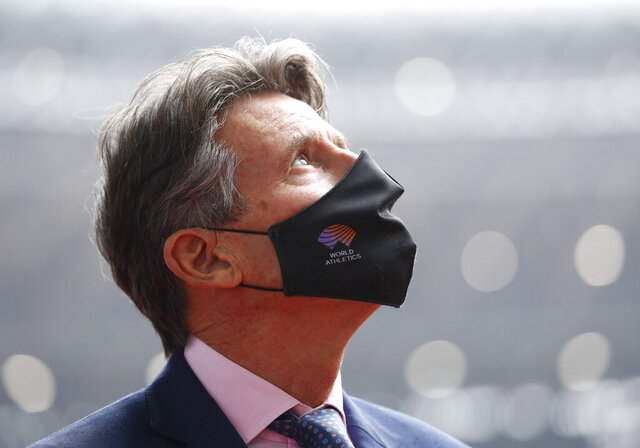 World Athletics President Sebastian Coe wearing a protective face mask inspects at the National Stadium, the main stadium of Tokyo 2020 Olympics and Paralympics, in Tokyo Thursday, Oct. 8, 2020. (Issei Kato/Pool Photo via AP)