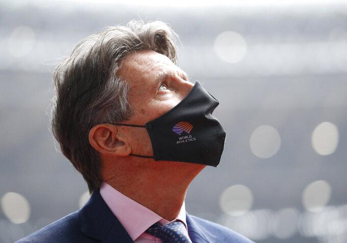 World Athletics President Sebastian Coe wearing a protective face mask inspects at the National Stadium, the main stadium of Tokyo 2020 Olympics and Paralympics, in Tokyo Thursday, Oct. 8, 2020. (Issei Kato/Pool Photo via AP)