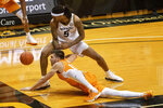The ball gets past Missouri's Mitchell Smith, top, and Tennessee's John Fulkerson, bottom, during the first half of an NCAA college basketball game Wednesday, Dec. 30, 2020, in Columbia, Mo. (AP Photo/L.G. Patterson)