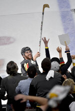 Vegas Golden Knights center Jonathan Marchessault gives away a stick after the team's 4-2 win against the Winnipeg Jets during Game 3 of the NHL hockey playoffs Western Conference finals Wednesday, May 16, 2018, in Las Vegas. (AP Photo/David Becker)