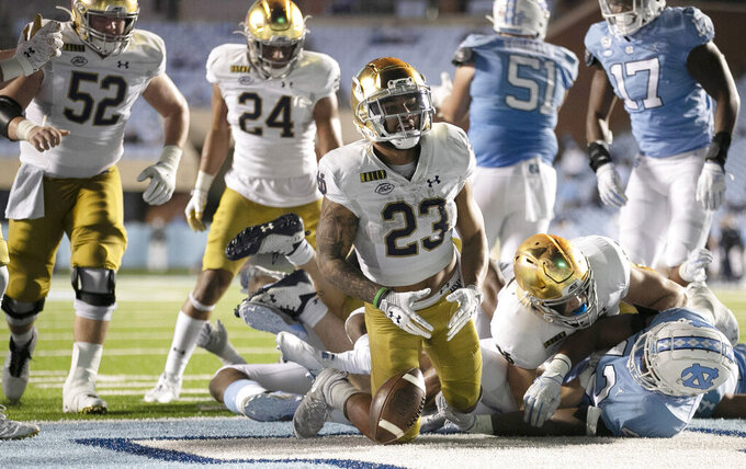 Notre Dame's Kyren Williams (23) reacts after scoring on a 1-yard carry against North Carolina during an NCAA college football game Friday, Nov. 27, 2020, in Chapel Hill, N.C. (Robert Willett/The News & Observer via AP, Pool)