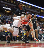 Hawaii guard Samuta Avea dives for the ball as Long Beach State guard Deishuan Booker watches during first half of an NCAA college basketball game at the Big West men's tournament in Anaheim, Calif., Thursday, March 14, 2019. (AP Photo/Chris Carlson)