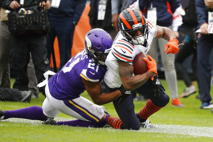 Chicago Bears wide receiver Allen Robinson, right, is pulled down by Minnesota Vikings cornerback Mike Hughes (21) after catching a pass during the half of an NFL football game Sunday, Sept. 29, 2019, in Chicago. (AP Photo/Charles Rex Arbogast)