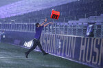 A fan takes advantage of a severe weather delay to throw a yardage marker into the stands at Husky Stadium during a weather delay in the first quarter of an NCAA college football game between Washington and California, Saturday, Sept. 7, 2019, in Seattle. The marker was later returned to the field. (AP Photo/Ted S. Warren)