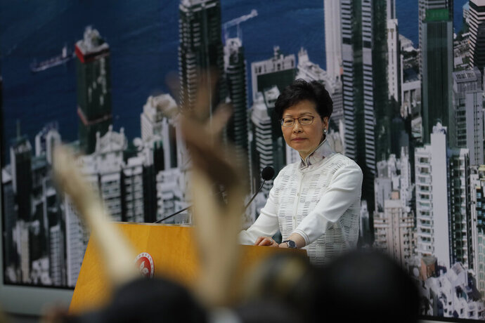 Hong Kong's Chief Executive Carrie Lam takes questions at a press conference, Saturday, June 15, 2019, in Hong Kong. Lam said she will suspend a proposed extradition bill indefinitely in response to widespread public unhappiness over the measure, which would enable authorities to send some suspects to stand trial in mainland courts. (AP Photo/Kin Cheung)