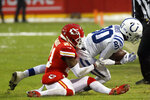 Kansas City Chiefs safety Eric Murray (21) tackles Indianapolis Colts wide receiver Chester Rogers (80) during the first half of an NFL divisional football playoff game in Kansas City, Mo., Saturday, Jan. 12, 2019. (AP Photo/Charlie Riedel)