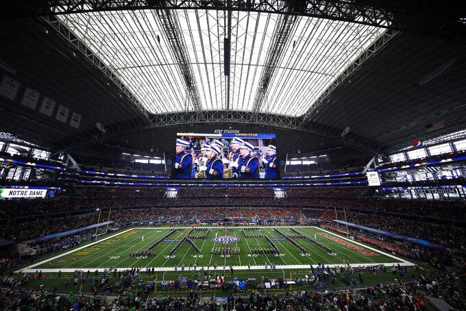The Notre Dame marching band performs before the NCAA Cotton Bowl semi-final playoff football game against Clemson on Saturday, Dec. 29, 2018, in Arlington, Texas. (AP Photo/Roger Steinman)