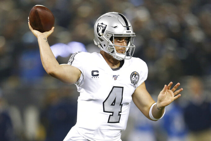 Oakland Raiders quarterback Derek Carr throws a pass against the Los Angeles Chargers during the first half of an NFL football game in Oakland, Calif., Thursday, Nov. 7, 2019. (AP Photo/D. Ross Cameron)