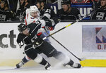 Los Angeles Kings' Derek Forbort, bottom, collides with Washington Capitals' Travis Boyd (72) during the first period of an NHL hockey game Monday, Feb. 18, 2019, in Los Angeles. (AP Photo/Marcio Jose Sanchez)