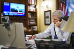 Sen. Rob Portman, R-Ohio, the top Republican negotiator on the bipartisan infrastructure bill, works from his office on Capitol Hill as he continues to shepherd the $1 trillion legislation closer to passage, in Washington, Monday, Aug. 9, 2021. (AP Photo/J. Scott Applewhite)