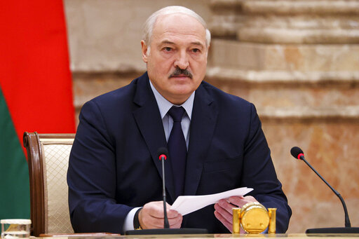 Belarusian President Alexander Lukashenko speaks during an expanded meeting of the Constitutional Commission in Minsk, Belarus, Tuesday, Sept. 28, 2021.The authoritarian leader of Belarus announced a referendum on a new constitution in Feb. 2022 and promised not to let the opposition come to power. Alexander Lukashenko told a government meeting Tuesday he had drafted a new constitution that redistributes powers between the main branches of the government and establishes a new governing body, the All-Belarus People's Assembly. (Maxim Guchek/BelTA photo via AP)