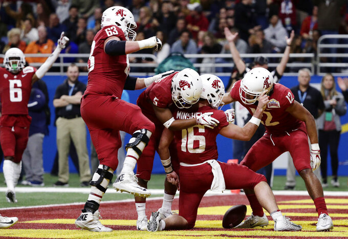 Washington State quarterback Gardner Minshew (16) celebrates with teammates after he scored a touchdown against Iowa State during the the first half of the Alamo Bowl NCAA college football game, Friday, Dec. 28, 2018, in San Antonio. (AP Photo/Eric Gay)