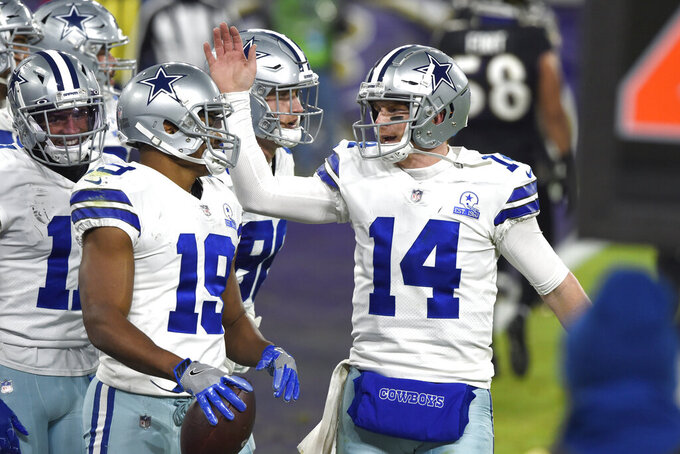 Dallas Cowboys quarterback Andy Dalton (14) and wide receiver Amari Cooper (19) react after they connected for a touchdown pass and catch against the Baltimore Ravens during the second half of an NFL football game, Tuesday, Dec. 8, 2020, in Baltimore. (AP Photo/Gail Burton)