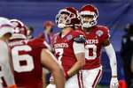 Oklahoma quarterback Spencer Rattler (7) celebrates after running the ball for a touchdown against Florida during the first half of the Cotton Bowl NCAA college football game in Arlington, Texas, Wednesday, Dec. 30, 2020. (AP Photo/Michael Ainsworth)