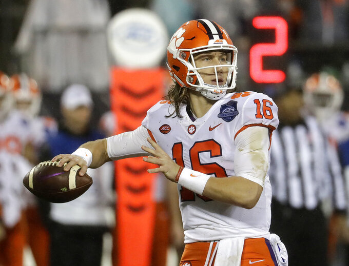 FILE - In this Dec. 1, 2018, file photo, Clemson's Trevor Lawrence (16) looks to pass against Pittsburgh in the first half of the Atlantic Coast Conference championship NCAA college football game, in Charlotte, N.C. No. 2 Clemson once again dominated the Associated Press All-Atlantic Coast Conference teams and individual awards released Tuesday, Dec. 4, 2018. Trevor Lawrence was voted the newcomer of the year. (AP Photo/Chuck Burton, File)