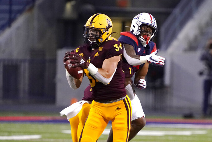 Arizona State linebacker Kyle Soelle (34) intercepts a pass intended for Arizona wide receiver Tre Adams during the first half of an NCAA college football game Friday, Dec. 11, 2020, in Tucson, Ariz. (AP Photo/Rick Scuteri)