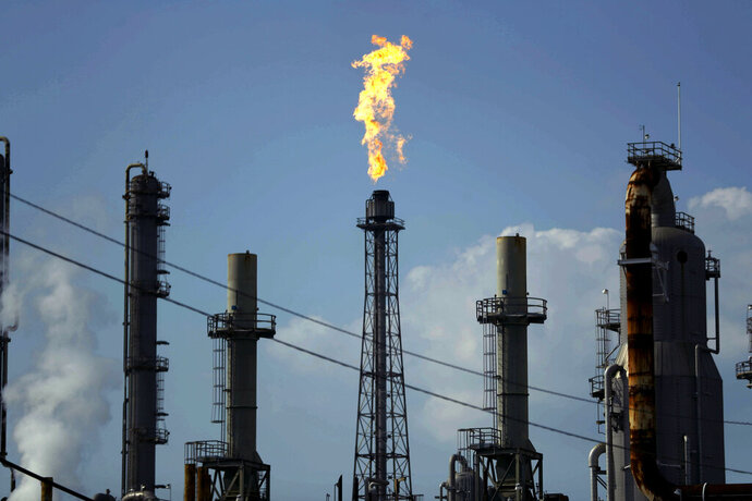 FILE - In this Thursday, Aug. 31, 2017, file photo, a flame burns at the Shell Deer Park oil refinery in Deer Park, Texas.  Iran has increased its offensive cyberattacks against the U.S. government and critical infrastructure as tensions have grown between the two nations, cybersecurity firms say.  In recent weeks, hackers believed to be working for the Iranian government have targeted U.S. government agencies, as well as sectors of the economy, including oil and gas, sending waves of spear-phishing emails, according to representatives of cybersecurity companies CrowdStrike and FireEye, which regularly track such activity.  (AP Photo/Gregory Bull, File)