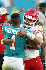Miami Dolphins quarterback Tua Tagovailoa (1) greets Kansas City Chiefs quarterback Patrick Mahomes (15) at the end of an NFL football game, Sunday, Dec. 13, 2020, in Miami Gardens, Fla. The Chiefs defeated the Dolphins 33-27. (AP Photo/Wilfredo Lee)