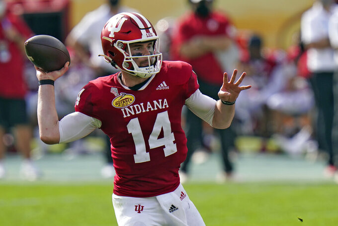 Indiana quarterback Jack Tuttle throws a pass against Mississippi during the first half of the Outback Bowl NCAA college football game Saturday, Jan. 2, 2021, in Tampa, Fla. (AP Photo/Chris O'Meara)