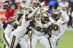 New Orleans Saints defensive tackle David Onyemata (93) celebrates with teammates after intercepting a pass by Tampa Bay Buccaneers quarterback Tom Brady (12) during the first half of an NFL football game Sunday, Nov. 8, 2020, in Tampa, Fla. (AP Photo/Mark LoMoglio)