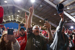 Supporters of President Donald Trump cheer as he arrives for a campaign rally, Friday, Oct. 12, 2018, in Lebanon, Ohio. (AP Photo/Evan Vucci)