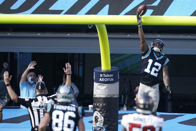 Carolina Panthers wide receiver D.J. Moore (12) celebrates his touchdown against the Tampa Bay Buccaneers during the first half of an NFL football game, Sunday, Nov. 15, 2020, in Charlotte , N.C. (AP Photo/Gerry Broome)