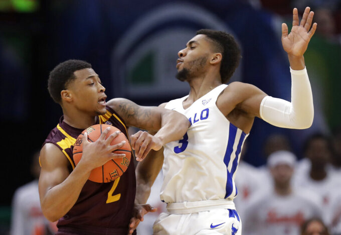 Central Michigan's Shawn Roundtree, left, drives past Buffalo's Jayvon Graves during the second half of an NCAA college basketball game in the semifinals of the Mid-American Conference men's tournament Friday, March 15, 2019, in Cleveland. Buffalo won 85-81. (AP Photo/Tony Dejak)