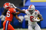 Ohio State running back Trey Sermon runs past Clemson safety Lannden Zanders during the first half of the Sugar Bowl NCAA college football game Friday, Jan. 1, 2021, in New Orleans. (AP Photo/Gerald Herbert)