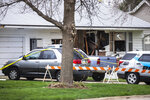 A Grundy Center police car parks outside a house with damage along G Avenue, Saturday, April 10, 2021, in Grundy Center, Iowa. An Iowa State Patrol trooper was killed during a standoff in central Iowa, the state Department of Public Safety said Saturday. The standoff came after a police chase ended at a Grundy Center home (Joseph Cress/Iowa City Press-Citizen via AP)