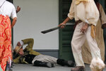 Plantation owner and slave owner Manuel Andry, portrayed by historian and photographer John,McCusker, is attacked by slaves during a performance artwork reenacting of the largest slave rebellion in U.S. history in LaPlace, La., Friday, Nov. 8, 2019. The reenactment was conceived by Dread Scott, an artist who often tackles issues of racial oppression and injustice. Scott says that those who took part in the 1811 rebellion were