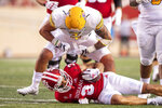 Idaho defensive player Fa'Avae Fa'Avae stands over the top of Indiana wide receiver Ty Fryfogle (3) after hitting him in the backfield during the first half of an NCAA college football game, Saturday, Sept. 11, 2021, in Bloomington, Ind. Fa'Avae was penalized for unsportsmanlike conduct on the play. (AP Photo/Doug McSchooler)