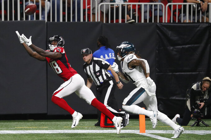 Atlanta Falcons wide receiver Calvin Ridley (18) misses a catch against Philadelphia Eagles cornerback Ronald Darby (21) during the first half of an NFL football game, Sunday, Sept. 15, 2019, in Atlanta. (AP Photo/John Bazemore)