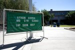 Temporary signs set up in front of main services building at Kiwanis Park lets patrons know what is open and what is closed as new rules have shut down many activities due to the surge in coronavirus cases Tuesday, June 30, 2020, in Tempe, Ariz. (AP Photo/Ross D. Franklin)