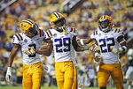 FILE - In this Sept. 8, 2018, file photo, LSU cornerback Greedy Williams (29) celebrates his interception with safety Grant Delpit (9) and cornerback Kristian Fulton (22) in the second half of an NCAA college football game against Southeastern Louisiana, in Baton Rouge, La. Williams was named to The Associated Press Midseason All-America team, Tuesday, Oct. 16, 2018. (AP Photo/Gerald Herbert, File)