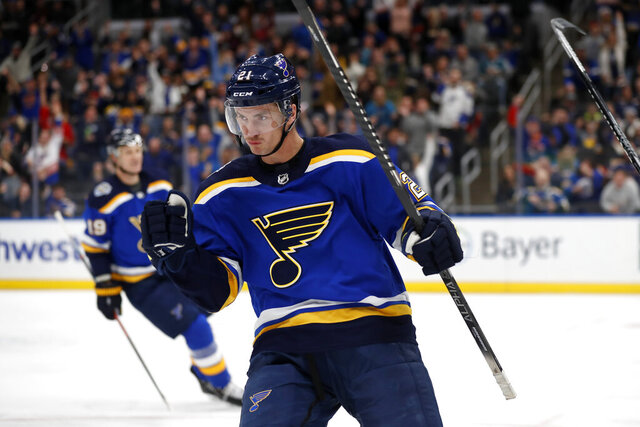 St. Louis Blues' Tyler Bozak celebrates after scoring during the second period of the team's NHL hockey game against the San Jose Sharks on Tuesday, Jan. 7, 2020, in St. Louis. (AP Photo/Jeff Roberson)
