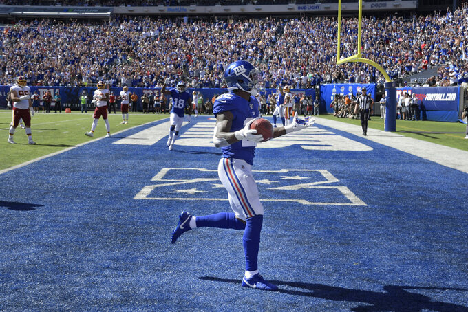 New York Giants running back Wayne Gallman reacts after scoring a touchdown during the first half of an NFL football game against the Washington Redskins, Sunday, Sept. 29, 2019, in East Rutherford, N.J. (AP Photo/Bill Kostroun)