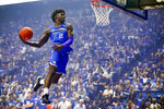 FILE - In this Oct. 11, 2019, file photo, Kentucky forward Kahlil Whitney goes up for a dunk during the NCAA college basketball team's Big Blue Madness at Rupp Arena in Lexington, Ky. Kentucky Gov. Andy Beshear signed an executive order Thursday, June 24, 2021, allowing the state's college athletes — including players on the nationally renowned Kentucky and Louisville men's basketball teams — to make money through the use of their name, image or likeness. (Alex Slitz/Lexington Herald-Leader via AP, File)