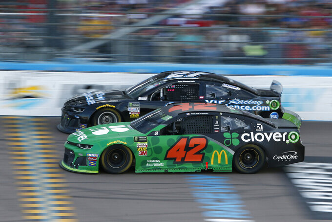 Kyle Larson (42) and Joe Nemechek (27) race side-by-side during the NASCAR Cup Series auto race at ISM Raceway, Sunday, Nov. 10, 2019, in Avondale, Ariz. (AP Photo/Ralph Freso)