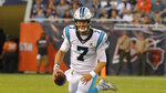 Carolina Panthers quarterback Kyle Allen scrambles during the first half of an NFL preseason football game against the Chicago Bears Thursday, Aug. 8, 2019, in Chicago. (AP Photo/Mark Black )