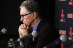 Boston Red Sox baseball team owner John Henry listens during a news conference at Fenway Park, Wednesday, Jan. 15, 2020, in Boston. The Boston Red Sox have parted ways with manager Alex Cora, with the move coming one day after baseball Commissioner Rob Manfred named him as a ringleader with Houston in the sport's sign-stealing scandal. (AP Photo/Elise Amendola)