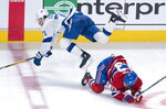 Tampa Bay Lightning's Anthony Cirelli trips over Montreal Canadiens' Max Domi during the second period of an NHL hockey game Tuesday, Oct. 15, 2019, in Montreal. (Paul Chiasson/The Canadian Press via AP)