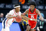 Mississippi guard Devontae Shuler (2) drives against Georgia's Sahvir Wheeler (15) in the first half of an NCAA college basketball game in the Southeastern Conference Tournament Wednesday, March 11, 2020, in Nashville, Tenn. (AP Photo/Mark Humphrey)
