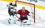 Minnesota Wild's Zach Parise jumps as Montreal Canadiens goaltender Carey Price snags the puck during first-period NHL hockey game action in Montreal, Thursday, Oct. 17, 2019. (Paul Chiasson/The Canadian Press via AP)
